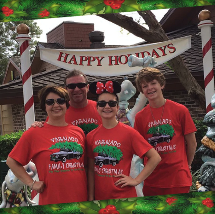 family of four in matching christmas t-shirts
